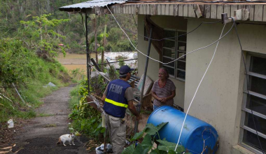 FEMA worker talking to resident